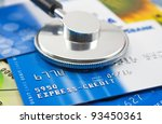 A stethoscope by a Credit cards payment - stock photo