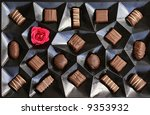 Chocolate box with a red rose - stock photo