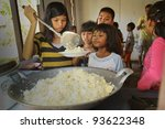 KO CHANG, THAILAND - JANUARY 6: Unknown children get food at lunch time at school by project Cambodian Kids Care to help deprived children in deprived areas, on January 6, 2012 in Ko Chang, Thailand. - stock photo