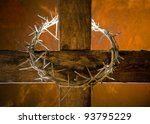 Crown of thorns hung around the Easter cross - stock photo