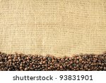 Old burlap and coffee beans background - stock photo