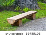 wooden bench under old oak - stock photo