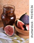Figs and jar with fig jam on background - stock photo