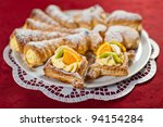 Dish full of cream pastries - stock photo