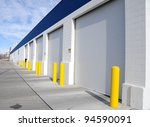 Multi-Door Garage in Industrial Area - stock photo