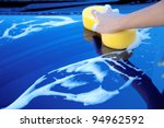 sponge over the car for washing - stock photo