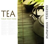 Asian tea set on bamboo mat(Green tea, palm leaf and chopsticks) with sample text - stock photo