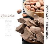 Crushed dark chocolate with cocoa beans - stock photo