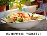 Prawn salad. Simple and healthy salad of shrimp, mixed greens and tomatoes - stock photo