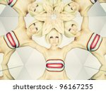 Bright young blonde in kaleidoscope of reflections - stock photo