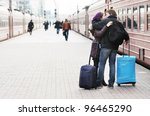 Happy young couple on railway station platform - stock photo