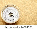 Retro barometer on gold background - stock photo