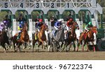 "ARCADIA, CA - MARCH 3: Jockey Martin Garcia pilots ""Stirred Up"" (second from right) to his first win at Santa Anita Race Track on March 3, 2012 in Arcadia, CA. - stock photo"