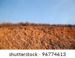 Beneath the asphalt and Layer of soil beneath the asphalt road - stock photo
