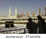 MECCA-FEB.26:Silhouette of unidentified Arabs & construction cranes in the background of Masjid Al Haram on Feb 26, 2012 in Mecca.Mecca currently in the process of expansion to cater for more pilgrims - stock photo