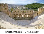 The Odeon of Herodes Atticus on the south slope of the Acropolis in Athens, Greece. c 161 AD.  The city of athens is in the background. - stock photo