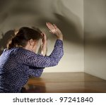 abused woman about to be hit - stock photo