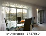 Staged dining room in a condominium for sale - stock photo