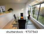 Staged dining room with a view - stock photo