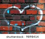Heart on a brick wall - stock photo