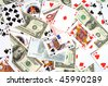 Background from playing cards and monetary denominations. - stock photo