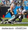 CHARLOTTE, NC - NOV 21:  Baltimore Ravens quarterback Joe Flacco gets sacked as the Carolina Panthers play the Baltimore Ravens on Nov 21, 2010 at Bank of America Stadium in Charlotte, NC. - stock photo