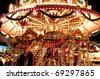 Children merry-go-round at Christmas market in Dresden, Germany. - stock photo
