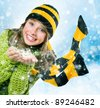 Christmas Girl.Winter Teenage girl Blowing Snow - stock photo
