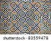 Detailed background  of the intricate tile patterns on a wall of the Nasrid Palace, Alhambra, Granada, Spain - stock photo