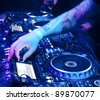 Dj playing the track in the nightclub at a party - stock photo