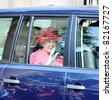 EDINBURGH - JULY 2: Queen Elizabeth II exits Holyrood Palace in the back of a motor vehicle on her way to present Colours to troops in Holyrood Park on July 2, 2011 in Edinburgh, Scotland. - stock photo
