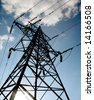 Electrical tower on a background of the blue sky - stock photo