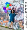 Happy woman with colorful balloons - stock photo
