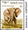 LAOS - circa 1986:stamp features an African elephant (loxodonta africana), circa 1986 in the Lao People's Democratic Republic. - stock photo