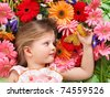 Little cute girl lying on the flower. - stock photo