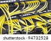 Patch Panel server rack with yellow cords - stock photo