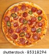 Pepperoni pizza with green chillies. - stock photo