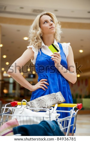 ... mall driving her trolley full of clothes, bags, shoes and other