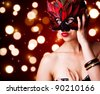portrait of beautiful woman in carnival mask - stock photo