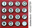 Red keypad with metal buttons - stock photo