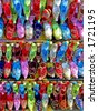 Several rows of colorful ethnic shoes on display - stock photo