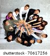Top view of business people with their hands together in a circle - stock photo