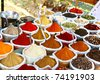 Various of Indian colored powder spices on the Anjuna flea market in India, Goa. - stock photo
