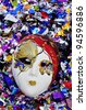 venetian carnival mask on a shiny confetti background - stock photo