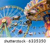 Vintage merry-go-round and ferris wheel - stock photo