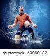 Water drops around football player under water on blue background - stock photo