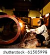 Worker welding steel - stock photo