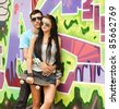 Young couple near graffiti background. - stock photo